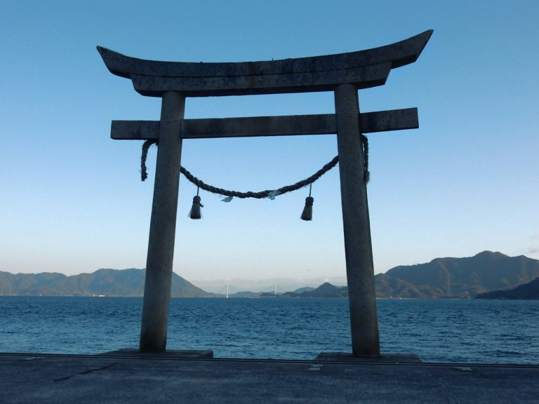 View of Seto Inland Sea through shrine gate in Tadanoumi